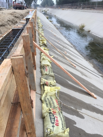 We built this concrete retaining wall in support of the Ontario water drainage system